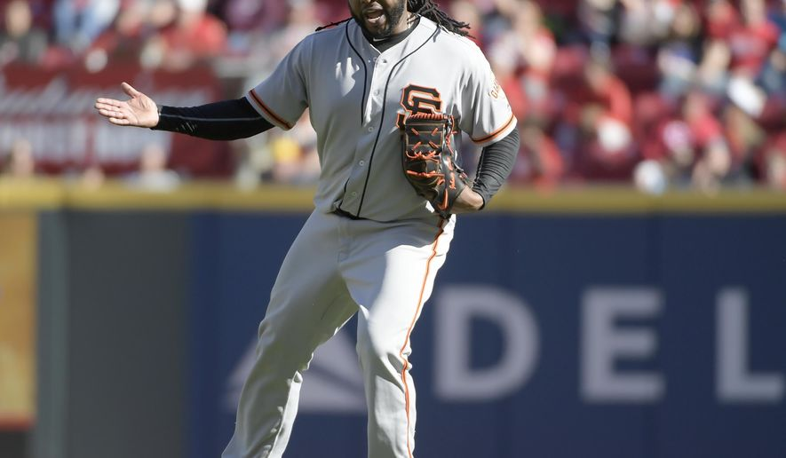 San Francisco Giants pitcher Johnny Cueto protests a balk called on him during the fifth inning of a baseball game against the Cincinnati Reds Sunday, May 7, 2017, in Cincinnati. (AP Photo/Michael E. Keating)