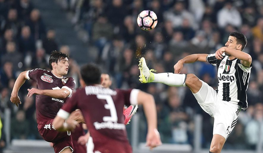 Juventus' Sami Khedira, right and Torino's Lucas Boye'  vie for the ball during the Italian Serie A soccer match between Juventus and Torino at the Juventus Stadium in Turin, Italy, Saturday, May 6, 2017. (Alessandro Di Marco/ANSA via AP)