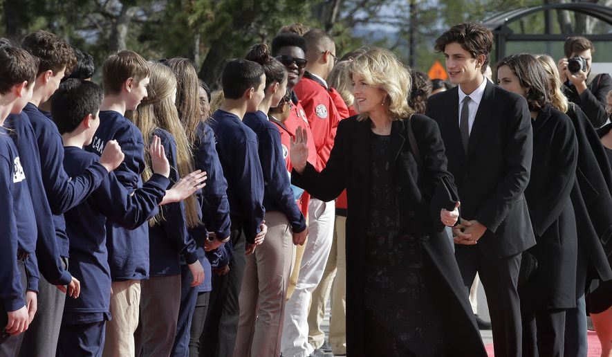 Former U.S. Ambassador to Japan Caroline Kennedy, center, and her son Jack Schlossberg, center right, greet members of Massachusetts state service organizations as they arrive at the John F. Kennedy Presidential Library and Museum before the 2017 Profile in Courage award Sunday, May 7, 2017, in Boston. Former President Barack Obama is to be presented with the award during the ceremonies. (AP Photo/Steven Senne)