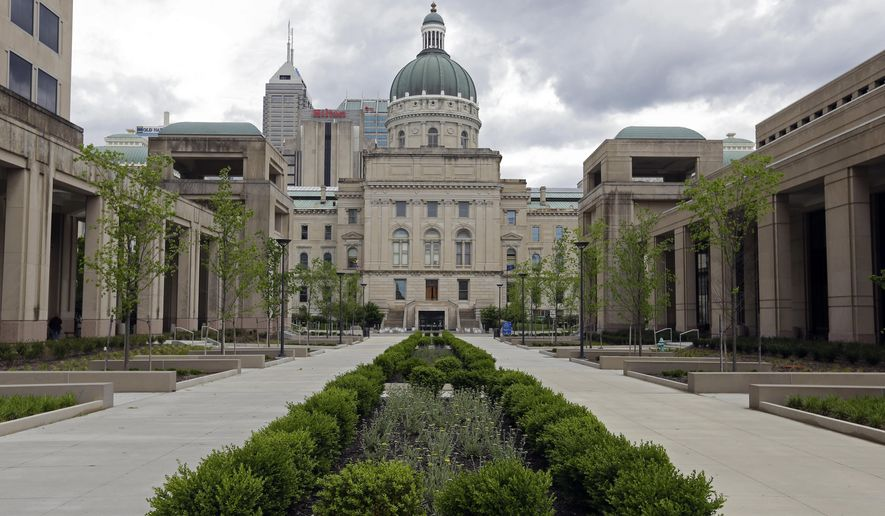 This Friday, May 5, 2017 photo shows the Bicentennial Plaza at the Indiana Statehouse in Indianapolis. Indiana lawmakers are bailing out the state's former governor, Vice President Mike Pence, after the Republican's efforts to pay for now-completed projects celebrating the state's bicentennial foundered. A provision tucked into the state's next two-year budget sets aside $5.5 million to pay for an elaborate plaza built outside the Statehouse in Indianapolis and upgrades to the state library. (AP Photo/Michael Conroy)
