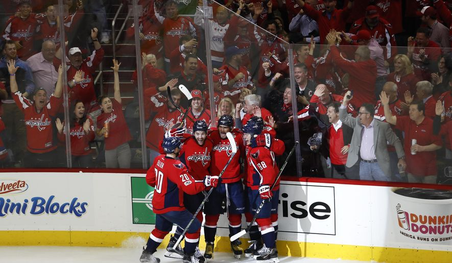 Washington Capitals left wing Alex Ovechkin (8), from Russia, celebrates scoring a goal against the Pittsburgh Penguins with teammates, Lars Eller (20) Tom Wilson (43), Kevin Shattenkirk (22), and Nate Schmidt (88), during the third period of Game 5 in the second-round of the NHL hockey Stanley Cup playoffs, Saturday, May 6, 2017, in Washington. The Capitals won 4-2. (AP Photo/Carolyn Kaster)