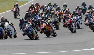 Moto2 rider Alex Marquez of Spain (number 73) rides into the first curve with the pack on his way to a win at the Spanish Motorcycle Grand Prix at the Jerez racetrack in Jerez de la Frontera, Spain, Sunday, May 7, 2017. (AP Photo/Miguel Morenatti)