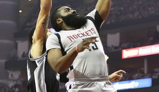 Houston Rockets guard James Harden (13) drives past San Antonio Spurs guard Danny Green (14) during the first half in Game 4 of an NBA basketball second-round playoff series, Sunday, May 7, 2017, in Houston. (AP Photo/Eric Christian Smith)