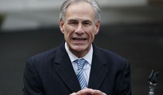 """FILE - In this March 24, 2017, file photo, Texas Gov. Greg Abbott talks to reporters outside the White House in Washington. Abbott tweeted the word """"Boom"""" in celebration of the Texas Legislature approving a call for a """"convention of states."""" The idea is for lawmakers in 34 states, representing two-thirds of the nation, to approve convening a gathering to amend the U.S. Constitution and include things like a federal balanced budget amendment to beat back Washington's """"overreach."""" (AP Photo/Evan Vucci, File)"""