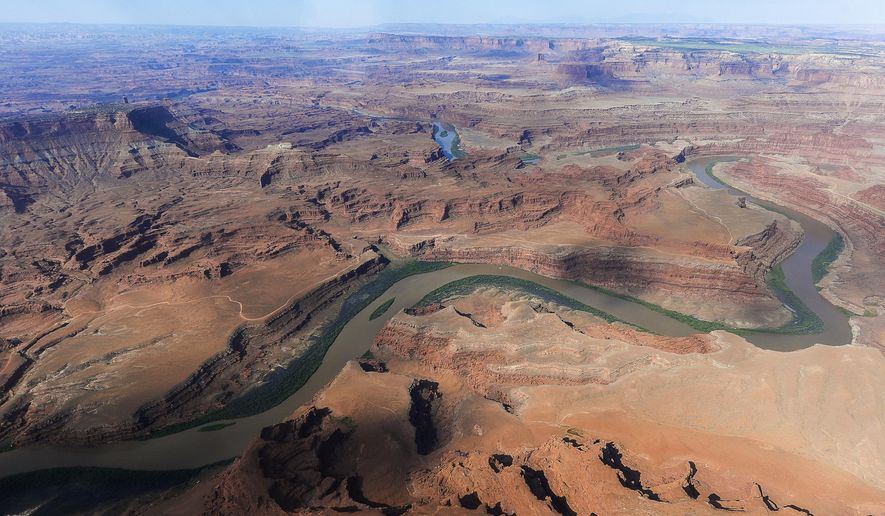 FILE - This May 23, 2016, file photo, shows the northernmost boundary of the proposed Bears Ears region, along the Colorado River, in southeastern Utah. The re-evaluation of the new Bears Ears National Monument and the Grand Staircase-Escalante National Monument is part of President Donald Trump's executive order calling for a review of 27 national monuments established by several former presidents. U.S. Interior Secretary Ryan Zinke is set to start a four-day Utah trip Sunday, May 7, 2017, to assess whether the designation of 3.2 million acres of national monuments in the state's southern red rock region should be scaled back or rescinded. (Francisco Kjolseth/The Salt Lake Tribune via AP file, File)
