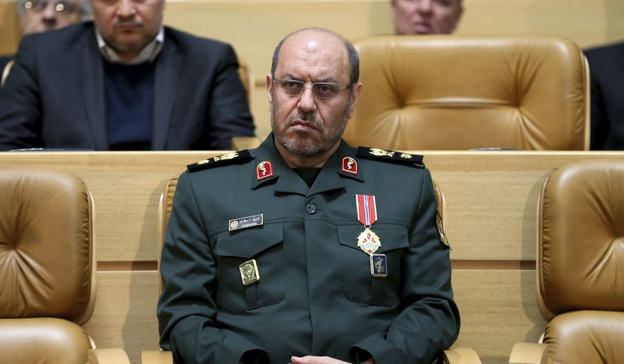"In this Feb. 8, 2016 file photo, Iranian Defense Minister Hossein Dehghan sits after being awarded the ""Medal of Courage"" by President Hassan Rouhani during a ceremony in Tehran, Iran. Dehghan lashed back on Monday, May 8, 2017, at Saudi Arabia, slamming the kingdoms Deputy Crown Prince Mohammed bin Salman over belligerent comments made last week. (AP Photo/Ebrahim Noroozi, File)"
