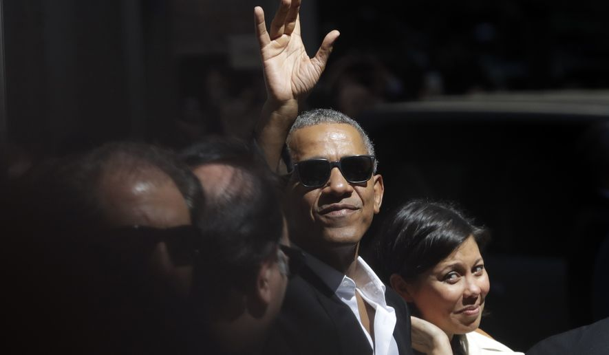 "United States former President Barack Obama waves as he leaves his hotel, in Milan, Monday, May 8, 2017. Obama, who is Italy for a two-day visit to participate at the ""Seeds&Chips - Global Food Innovation"" summit, is also meeting former Italian premier Matteo Renzi and representatives of the local business community. (AP Photo/Luca Bruno)"