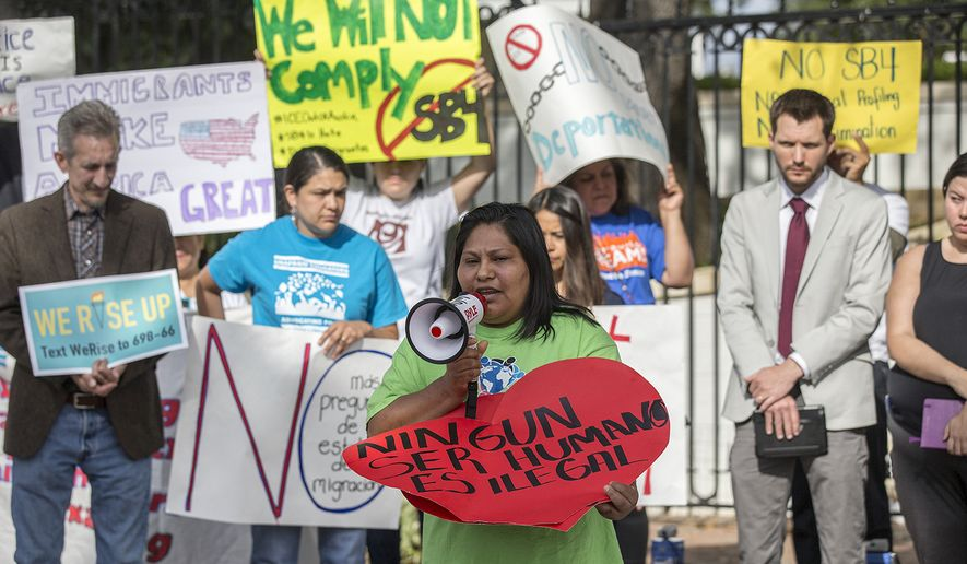 Maria Duque speaks during a protest outside of the Texas Governor's Mansion in Austin, Texas, Monday, May 8, 2017. The gathering was to protest a law, which takes effect in September and which critics say is the most anti-immigrant since a 2010 Arizona law, that will allow police officers to ask about the immigration status of anyone they detain, including during routine traffic stops. Republican Gov. Greg Abbott signed the law Sunday evening on Facebook Live with no advanced warning. (Ricardo B. Brazziell/Austin American-Statesman via AP)