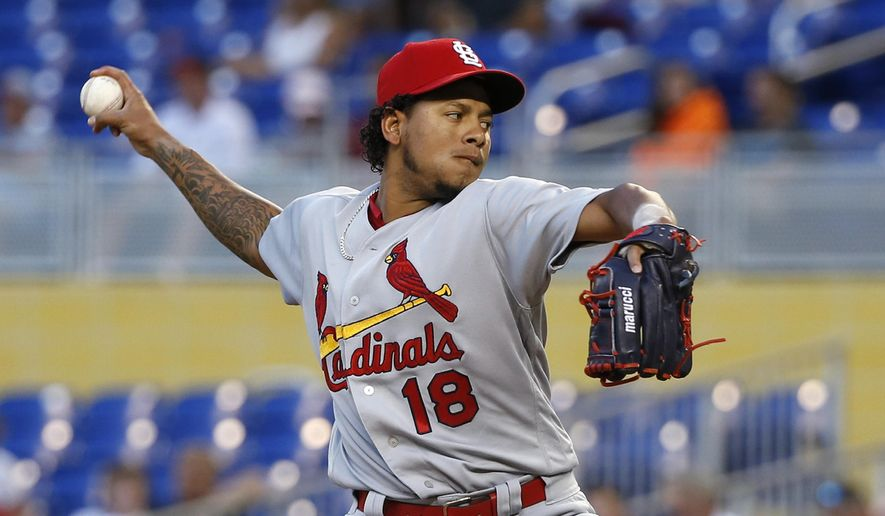 St. Louis Cardinals' Carlos Martinez delivers a pitch during the first inning of a baseball game against the Miami Marlins, Monday, May 8, 2017, in Miami. (AP Photo/Wilfredo Lee)