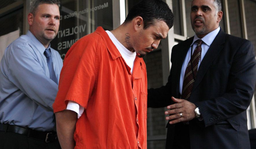 FILE - In this April 22, 2009 file photo, Ingmar Guandique is escorted from the Violent Crimes Unit in Washington. Guandique, whose conviction in the slaying of missing intern Chandra Levy was overturned has been deported. Immigration and Customs Enforcement (ICE) officials said that Guandique was flown Friday, May 5, 2017, to San Salvador and transferred to authorities there.  (AP Photo/Jacquelyn Martin, File)