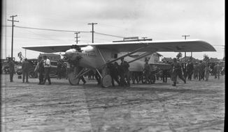 In this April 28, 1927, photo, Charles A. Lindberg does a test flight of the Spirit of St. Louis, the plane custom-built in San Diego by Ryan Airlines. Photos tucked away for 90 years in a California newspaper's archives portray Charles Lindbergh just weeks before he made the first-ever nonstop solo airplane flight across the Atlantic Ocean. Three weeks after they were taken, Lindbergh and his aircraft made history by flying from New York to Paris, 3,610 miles in 33 hours. (Harry T. Bishop/The San Diego Union-Tribune via AP)