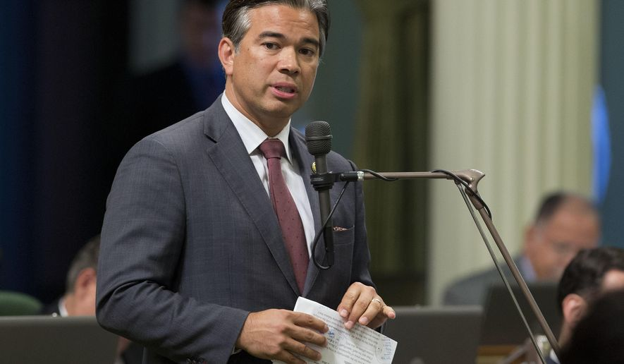 FILE -- In this Aug. 31, 2016 file photo Assemblyman Rob Bonta, D-Alameda, speaks during a legislative session, in Sacramento, Calif. The Assembly approved Bonta's measure, AB22 that would prevent California state employees from being fired for being a member of the Communist Party. The bill now goes to the Senate. (AP Photo/Rich Pedroncelli)