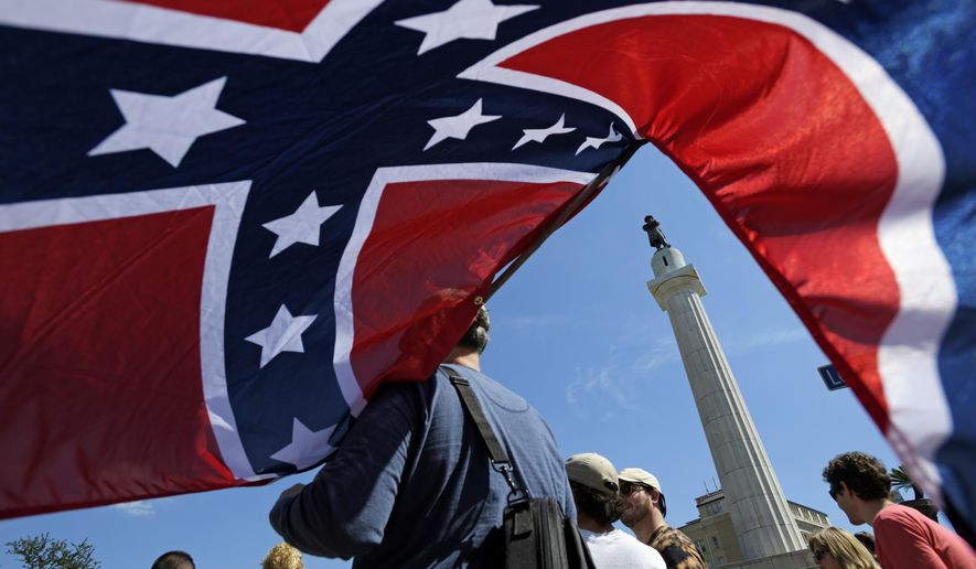 Protesters calling for the removal and the preservation of Confederate-era monuments face off in dueling demonstrations, Sunday, May 7, 2017, in New Orleans. (Max Becherer/The Advocate via AP) ** FILE **