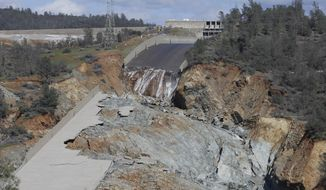FILE- In this Feb. 28, 2017 file photo, a small flow of water goes down Oroville Dam's crippled spillway in Oroville, Calif. California is asking the federal government to pay for 75 percent of the hundreds of millions of dollars in repairs to the badly damaged spillways at the nation's tallest dam, a state water agency spokeswoman said Monday, May 8, 2017. (AP Photo/Rich Pedroncelli, File)