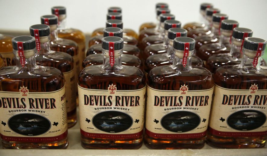 Devils River Whiskey bottles are displayed on a cart after being bottled at a facility in Dallas on March 22, 2017.  Devils River is the latest to join North Texas' burgeoning small-batch distillery scene, which is gaining momentum like the craft brewery movement before it. Between 1995 and 2008, the Texas Alcoholic Beverage Commission issued 10 licenses to spirits manufacturers.  (Rose Baca/The Dallas Morning News via AP)