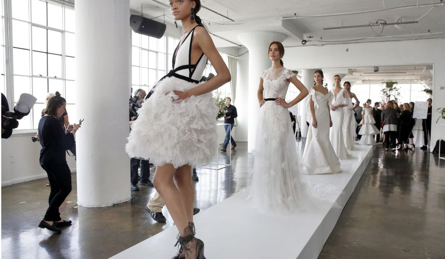FILE - In this April 20, 2017, file photo, the Marchesa bridal collection is presented during bridal fashion week in New York. The recent round of spring 2018 bridal shows pointed to a turn back to tradition, sometimes with modern twists, along with plenty of options in silhouettes. (AP Photo/Richard Drew, File)