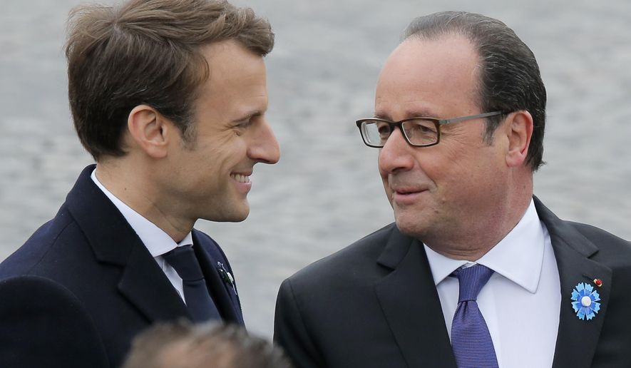 President-elect Emmanuel Macron, left, and current French President Francois Hollande attend a ceremony to mark the end of World War II in Paris, France, Monday, May 8, 2017. French president-elect Emmanuel Macron, will appear Monday alongside current President Francois Hollande in commemoration of the end of World War II. Monday, a national holiday, marks the day of the formal German defeat in World War II. (AP Photo/Michel Euler)