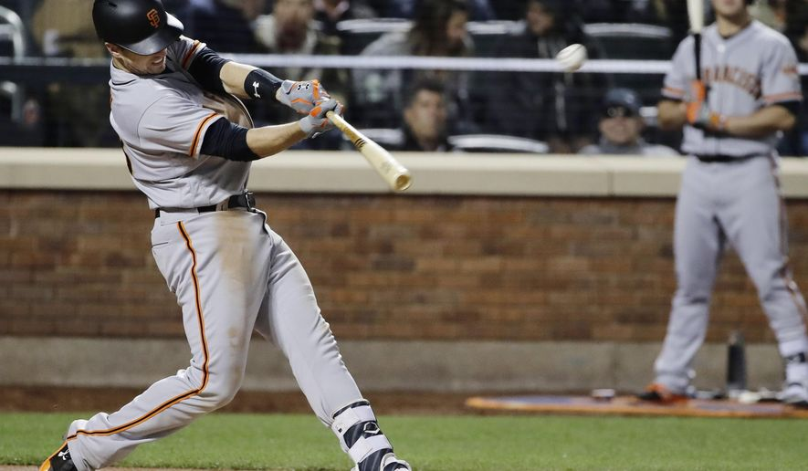 San Francisco Giants' Buster Posey hits a home run during the sixth inning of a baseball game against the New York Mets, Monday, May 8, 2017, in New York. (AP Photo/Frank Franklin II)
