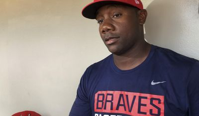 In this photo taken May 3, 2017, Gwinnett Braves' Ryan Howard is interviewed before a minor league baseball game against the Durham Bulls in Gwinnett, Ga. The Braves have released the former National League MVP from his minor league contract after he struggled at Triple-A Gwinnett. (AP Photo/Paul Newberry, file)