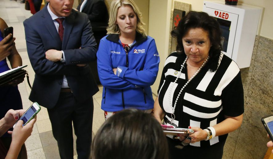 Sally Van Schenck, right, communications director for the Tulsa County District Attorney, talks with the media before jury selection for the trial of Tulsa police officer Betty Shelby gets underway in Tulsa, Okla., Monday, May 8, 2017. Shelby is charged with manslaughter in the shooting of Terence Crutcher, an unarmed black man. (AP Photo/Sue Ogrocki)