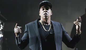 FILE - In this Nov. 4, 2016 file photo, Jay Z performs during a campaign rally for Democratic presidential candidate Hillary Clinton in Cleveland. The Meadows Music and Arts Festival announced May 8, 2017, that Jay Z would headline the second edition of the New York concert in September.  (AP Photo/Matt Rourke, File)