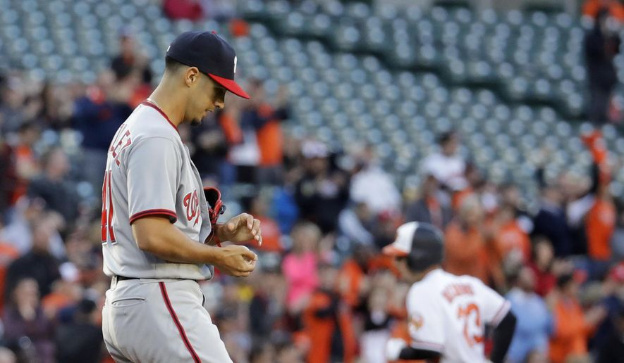 Washington Nationals starting pitcher Gio Gonzalez stands on the mound as Baltimore Orioles' Joey Rickard, back right, rounds the bases after hitting a solo home run in the first inning of an interleague baseball game in Baltimore, Monday, May 8, 2017. (AP Photo/Patrick Semansky)