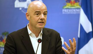 """FILE - In this Saturday, April 29, 2017 file photo, FIFA President Gianni Infantino gives a press conference at the National Palace in Port-au-Prince, Haiti. An accelerated process to hand North America the 2026 World Cup is set to be approved by soccer leaders this week, with FIFA President Gianni Infantino hoping for a """"bulletproof"""" process to avoid past voting scandals. The United States, Canada, and Mexico are seeking an unchallenged path to co-hosting rights for the 2026 showpiece, if FIFA's technical requirements are met by next year """"It's an interesting, original proposal and we will discuss it tomorrow at the council and present the recommendation to the congress,"""" Infantino told The Associated Press on Monday, May 8, 2017 .(AP Photo/Dieu Nalio Chery, file)"""