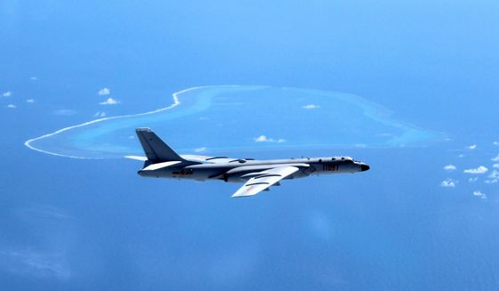 In this undated photo released by Xinhua News Agency, a Chinese H-6K bomber patrols the islands and reefs in the South China Sea. China's state broadcaster showed on Sunday, May 7, 2017, navy fighter bombers taking part in exercises over the South China Sea, including one involving the detection and expulsion of foreign military surveillance aircraft such as those deployed regularly in the area by the U.S. and others. The video shown on CCTV's military channel shows a squadron of two-seater Xian JH-7 Flying Leopards flying in formation and dropping bombs on targets in the ocean below. (Liu Rui/Xinhua via AP, File)