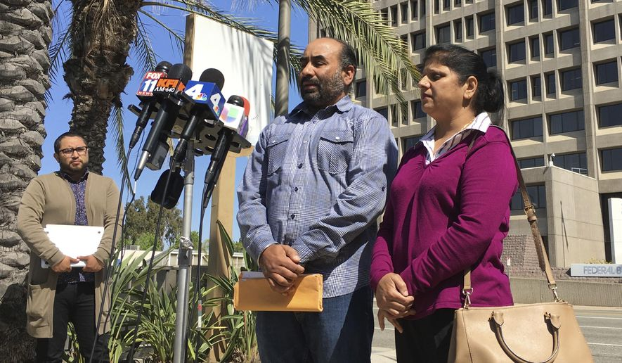 Gurmukh Singh, accompanied by his wife, talks during a news conference prior to his immigration check-in outside the Immigration and Customs Enforcement's offices in Santa Ana, Calif. on Monday, May 8, 2017. Singh a taxi driver originally from India has been detained by U.S. immigration authorities during a check-in for an 18-year-old deportation order. (AP Photo/Amy Taxin)
