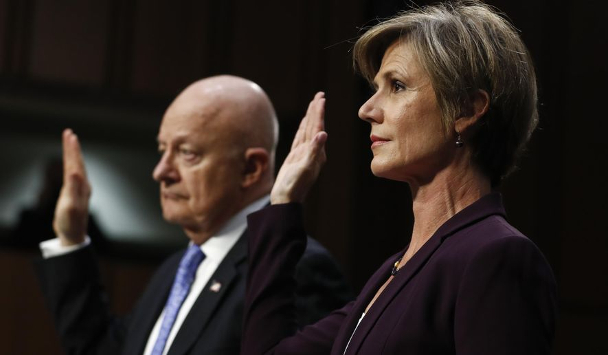 "Former acting Attorney General Sally Yates, right, and former National Intelligence Director James Clapper, are sworn-in on Capitol Hill in Washington, Monday, May 8, 2017, prior to testifying before the Senate Judiciary subcommittee on Crime and Terrorism hearing: ""Russian Interference in the 2016 United States Election."" (AP Photo/Carolyn Kaster)"