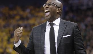 Golden State Warriors interim head coach Mike Brown shouts to his team in the first half during Game 4 of the NBA basketball second-round playoff series against the Utah Jazz Monday, May 8, 2017, in Salt Lake City. (AP Photo/Rick Bowmer)