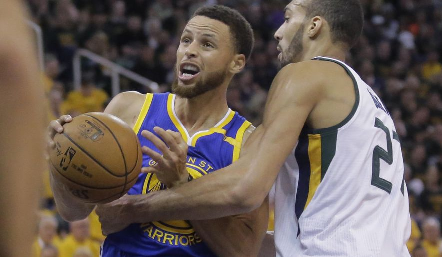 Golden State Warriors guard Stephen Curry, left, goes to the basket as Utah Jazz center Rudy Gobert (27) defends in the first half during Game 4 of the NBA basketball second-round playoff series Monday, May 8, 2017, in Salt Lake City. (AP Photo/Rick Bowmer)