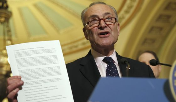 """Senate Minority Leader Charles E. Schumer, New York Democrat, displays a letter to Republicans about health care while speaking to the media last week We didn't lay out our exact specific plan,"""" Mr. Schumer told reporters. """"We laid out where we want to go."""" (Associated Press)"""