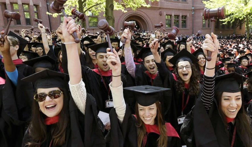 Graduates of Harvard Law School wave gavel during commencement ceremonies on May 29, 2014, in Cambridge, Mass. (Associated Press) ** FILE **