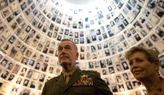 U.S. Chairman of the Joint Chiefs of Staff Gen. Joseph Dunford and his wife Ellyn Dunford visit the Hall of Names at the Yad Vashem Holocaust Memorial in Jerusalem, Tuesday, May 9, 2017. (AP Photo/Ariel Schalit) ** FILE **