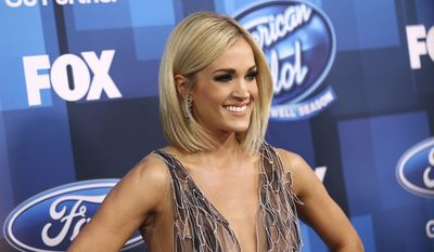 "In this Thursday, April 7, 2016, file photo, Carrie Underwood arrives at the ""American Idol"" farewell season finale at the Dolby Theatre in Los Angeles. ABC said it will revive ""American Idol"" after it has spent only one year off the air. (Photo by John Salangsang/Invision/AP, File)"