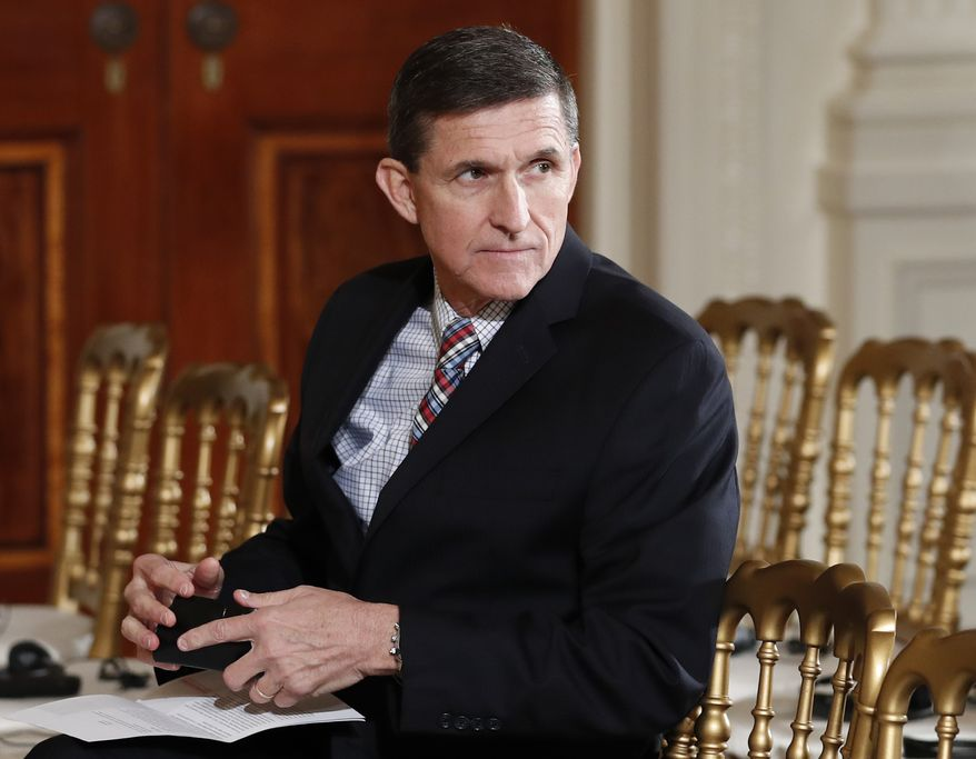 In this Feb. 10, 2017, file photo, then-National Security Adviser Michael Flynn sits in the East Room of the White House in Washington. (AP Photo/Carolyn Kaster, File)