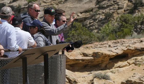 Interior Secretary Ryan Zinke (third from left in sunglasses), is joined by San Juan County Commission Chairman Phil Lyman as he overlooks the Butler Wash Indian Ruins within the Bears Ears National Monument near Blanding, Utah. (Associated Press)