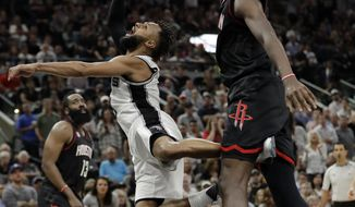 San Antonio Spurs guard Patty Mills (8) has his shot blocked by Houston Rockets' Clint Capela, right, during the second half in Game 5 of an NBA basketball second-round playoff series, Tuesday, May 9, 2017, in San Antonio. (AP Photo/Eric Gay)
