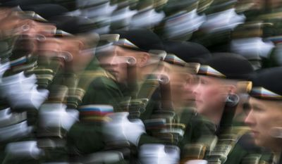 Russian soldiers march along Red Square during the Victory Day military parade in Moscow, on Tuesday, May 9, 2017. Victory Day is Russia's most important secular holiday, commemorating the Red Army's determination and losses in World War II. (AP Photo/Alexander Zemlianichenko)