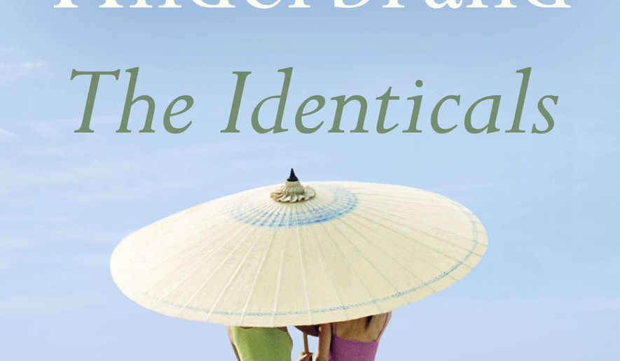 """This cover image released by Little, Brown and Company shows """"The Identicals,"""" by Elin Hilderbrand, available on June 13. (Little, Brown and Company via AP)"""