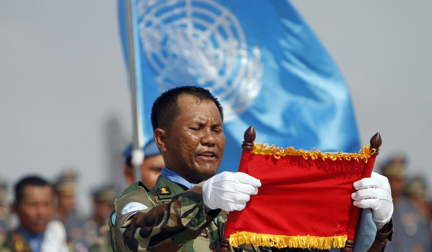 FILE - In this April 7, 2015, file photo, A Cambodian soldier who leads a troop takes the oath of the United Nations mission in Mali and South Sudan in Africa during a send-off ceremony for the Cambodian military personnel at the Royal Cambodian Air Force in Phnom Penh, Cambodia. Attackers in Central African Republic, the western neighbor nation of South Sudan, ambushed a convoy of U.N. peacekeepers, killing one Cambodian soldier and wounding another, Cambodia's prime minister said Tuesday, May 9, 2017. (AP Photo/Heng Sinith, File)