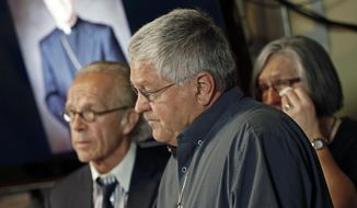 Ron Vasek, center, talks of the alleged sex abuse coverup he suffered while addressing a news conference along with his wife Patty, right, and attorney Jeff Anderson, left, Tuesday, May 9, 2017 in St. Paul, Minn. Anderson announced a lawsuit against Bishop Michael Hoeppner of Crookston, Minn., accusing the bishop and diocese of concealing a report of abuse and threatening retaliation against Vasek if he went public. (AP Photo/Jim Mone)