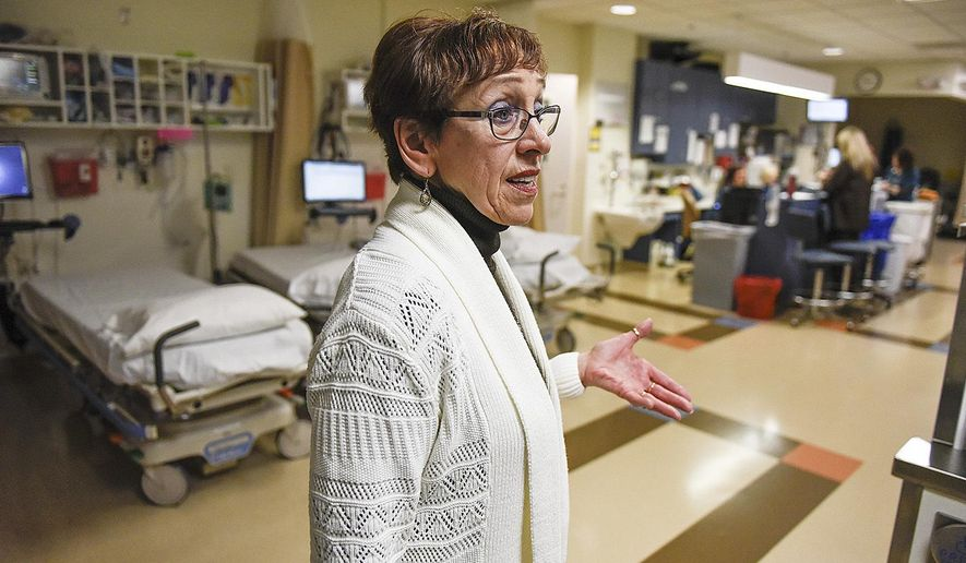 FOR RELEASE MONDAY, MAY 15, 2017, AT 12:01 A.M. CDT.-Jeanette Stack, administrator of the St. Cloud Surgical Center, St. Cloud, Minn., makes sure everything is on schedule Wednesday, March 8, 2017, in a recovery area. (Jason Wachter/St. Cloud Times via AP)