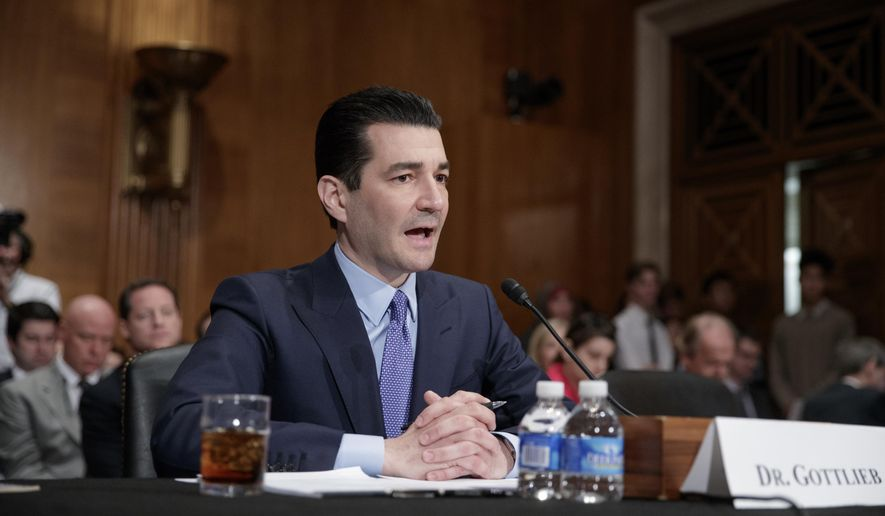 FILE - In this April 5, 2017 file photo, Food and Drug Administration (FDA) Commissioner-designate Dr. Scott Gottlieb testifies on Capitol Hill in Washington at his confirmation hearing before the Senate Health, Education, Labor, and Pensions Committee. The Senate is on track to confirm Gottlieb as the head of the Food and Drug Administration.  (AP Photo/J. Scott Applewhite)