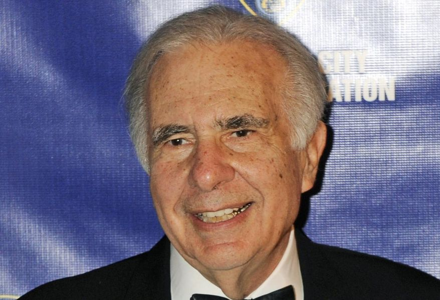 In this March 16, 2010, file photo, financier Carl Icahn poses for photos upon arriving for the annual New York City Police Foundation Gala in New York. (AP Photo/Henny Ray Abrams, File)