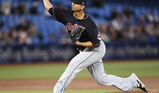 Cleveland Indians starting pitcher Carlos Carrasco throws against the Toronto Blue Jays during the first inning of a baseball game Tuesday, May 9, 2017, in Toronto. (Frank Gunn/The Canadian Press via AP)