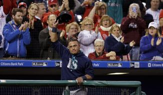 Seattle Mariners catcher Carlos Ruiz, a former Philadelphia Phillies player, acknowledges the crowd during the third inning of a baseball game, Tuesday, May 9, 2017, in Philadelphia. (AP Photo/Matt Slocum)