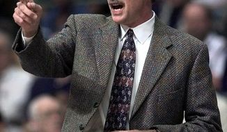 FILE - In this March 8, 2000, file photo, Detroit Pistons coach George Irvine directs players from the bench during an NBA game against the Denver Nuggets in Auburn Hills, Mich. The Indiana Pacers say former NBA coach George Irvine has died. He was 69 and had been battling cancer. The Pacers announced the death Tuesday, May 9, 2017, after speaking with Irvine's family. (AP Photo/Duane Burleson, File)