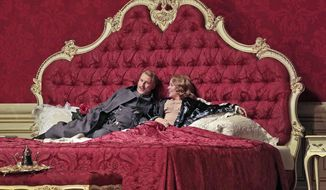 "This April 3, 2017 photo released by the Metropolitan Opera shows Guenther Groissboeck, left, and Renee Fleming during a performance Richard Strauss' ""Der Rosenkavalier,"" in New York. (Ken Howard/Metropolitan Opera via AP)"
